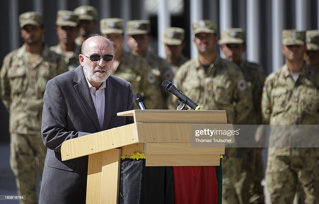 Afghan Interior Minister Omar Daudzai speak during a ceremonial handover at PRT Kunduz on October 06, 2013 in Kunduz, Afghanistan. Westerwelle and de Maiziere visit Afghanistan to hand over German PRT in Kunduz to the Afghan Military.
