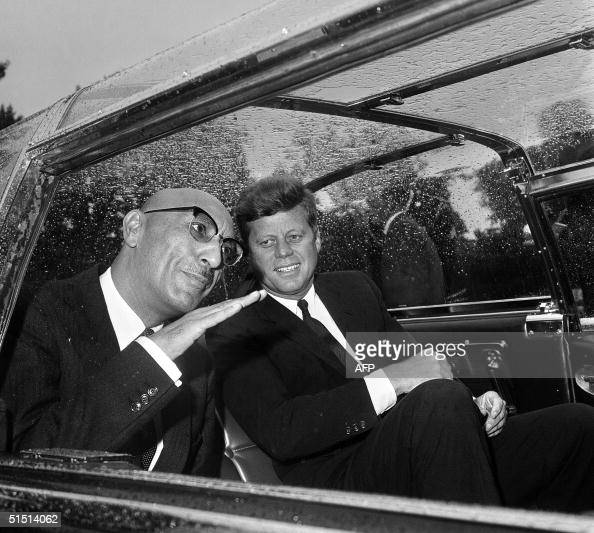 Afghan King Mohammad Zahir Shah talks with US President John F Kennedy in the car that takes them to the White House 08 September 1963 in Washington...