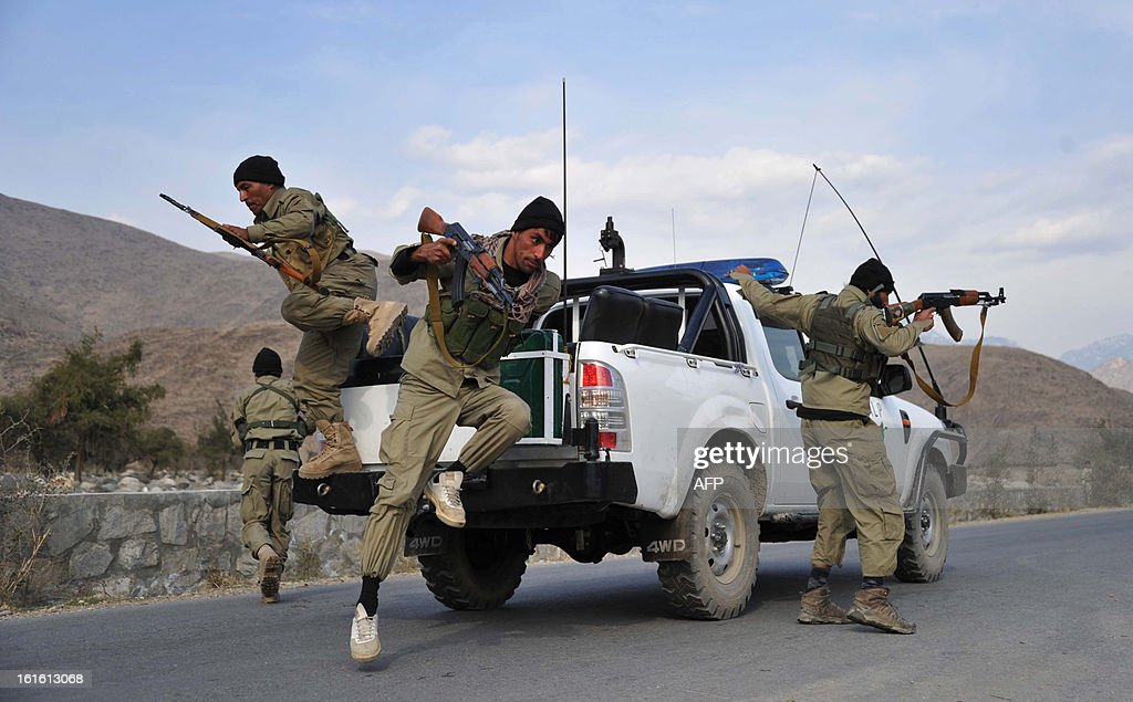 Afghan Local Police (ALP) personnel jump from their vehicle as they patrol in Nor Gal district Kunar province on February 13, 2013. The Afghan government welcomed President Barack Obama's announcement that the United States will withdraw 34,000 troops from the war-torn country over the next year. NATO, which has about 37,000 troops in Afghanistan, will also withdraw them in stages before the end of 2014. AFP PHOTO/ Noorullah Shirzada