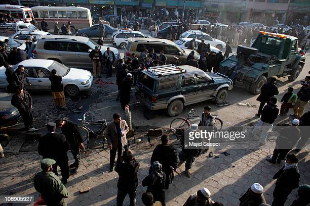 Afghan locals inspect the site of a explosion from a car bomb in a busy shopping street on February 8 2011 in Kabul Afghanistan No casualties were...