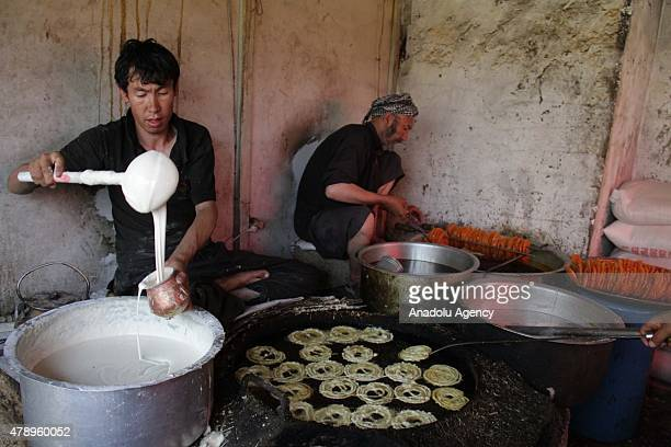Afghan man prepares Jalebi a traditional dessert for sale during the Islamic holy month of Ramadan in Kabul Afghanistan 29 June 2015