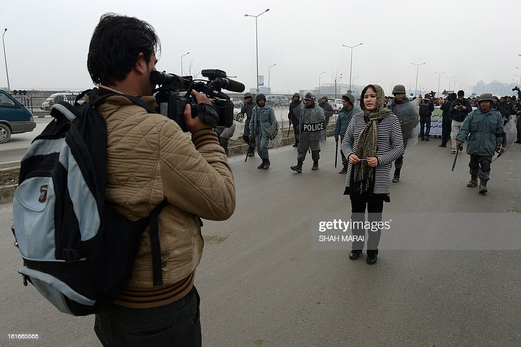 Afghan media compile a report during a protest calling for an end to violence against women in Afghanistan and around the world, in Kabul on February 14, 2013. According to a UN report, Afghanistan has made progress in protecting women against violence, but many still suffer horrific abuse 11 years after a US-led invasion brought down the Taliban regime. Afghan women still endure killings by relatives in the name of family honour, forced marriages and domestic abuses. AFP PHOTO/SHAH Marai