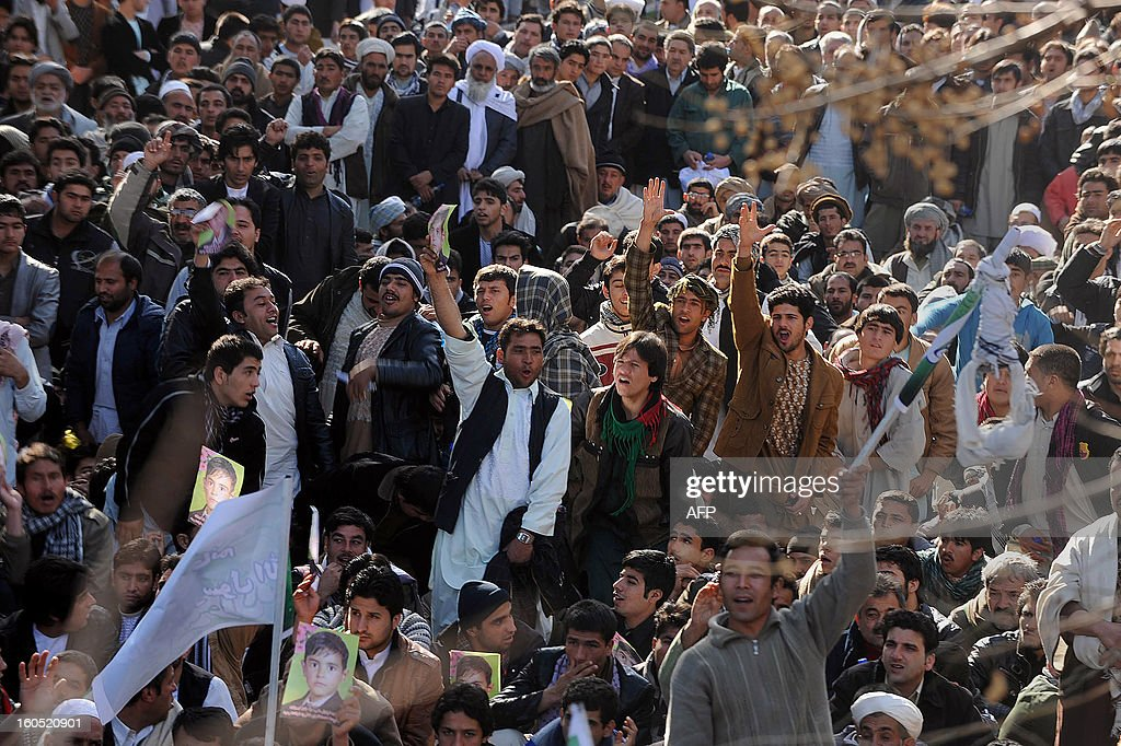 Afghan men chant for justice and punishment for kidnapping gangs involved in the killing of a boy during a demonstration in Herat on February 2, 2013. Thousands of Afghan men and women on Saturday gathered in western Afghanistan to protest the killing of 10-year old boy, the son of a businessman. About 4,000 to 5,000 protesters mostly businessmen, city's shopkeepers, civil society members protested outside Herat governor's office, chanting for justice and punishment for kidnapping gangs involved in killing of a boy. AFP PHOTO/Aref Karimi