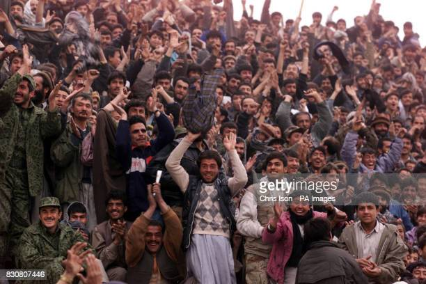 Afghan men cheer their side's openning goal in a soccer match at the Olympic Stadium in Kabul Afghanistan between ISAF and Kabul FC The game was...
