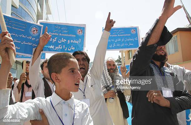 Afghan men hold banners and shout slogans during AntiPakistan protest against rocket attacks allegedly fired by Pakistani security forces from across...