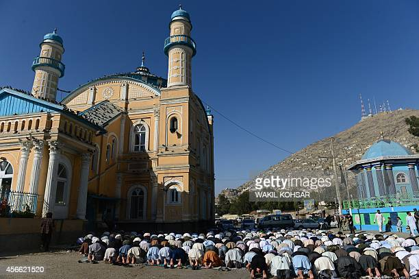 Afghan men offer EidalAdha prayer at the Shahe Do Shamshira mosque in Kabul on October 4 2014 Afghans started celebrating Eid alAdha or 'Feast of the...