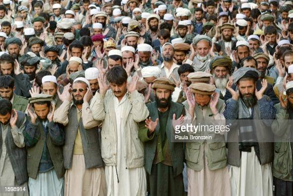 Afghan men pray at the Blue Mosque on the first Friday of the fasting month of Ramadan November 8 2002 in Kabul Afghanistan