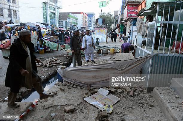 Afghan men remove debris after a powerful earthquake hit Kabul on October 26 2015 A powerful 75 magnitude earthquake killed at least 74 people as it...