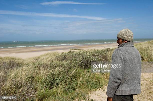 Afghan migrant Asif Hussainkhil looks at the English channel that he desperately attempted to cross in Calais France on May 7 2014 Asif Hussainkhil...
