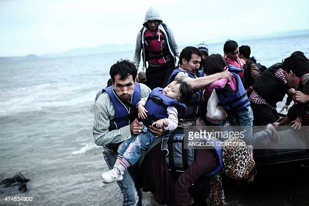 Afghan migrants arrive on a beach on the Greek island of Kos after crossing a part of the Aegean Sea between Turkey and Greece on May 27 2015 AFP...