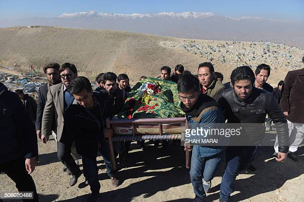 Afghan mourners carry the coffin of Saeed Jawad Hossini who was killed in a suicide attack on a minibus carrying employees of Afghan TV channel TOLO...