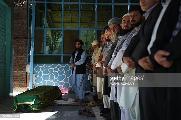 Afghan mourners offer funeral prayers for Afghan reporter Zabihullah Tamanna at a mosque in Kabul on June 7 2016 Zabihullah Tamanna a 38yearold...