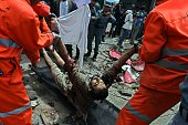 Afghan municipality workers carry the body of a Taliban militant after an attack on the Afghan parliament building in Kabul on June 22 2015 Taliban...