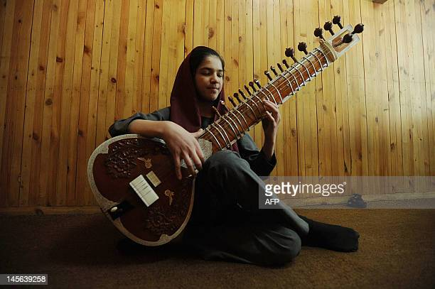 Afghan music student Homa plays the sitar at Afghanistan's National Institiute for Music in Kabul on June 3 2012 The Afghanistan National Institute...