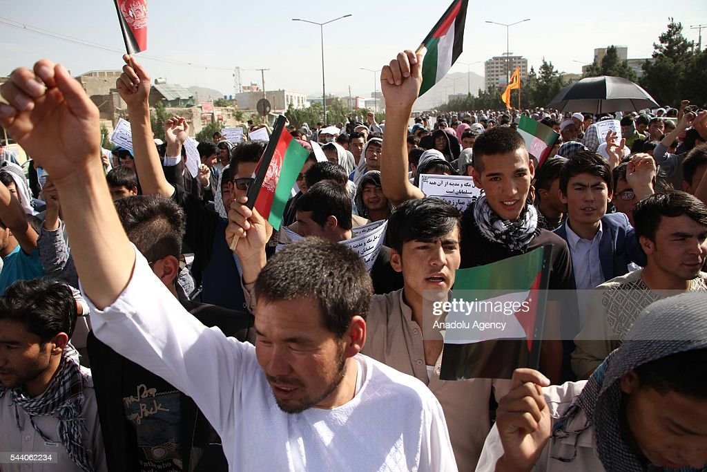 Afghan Muslims attend a rally to mark the International Quds Day in Kabul, Afghanistan on July 1, 2016.