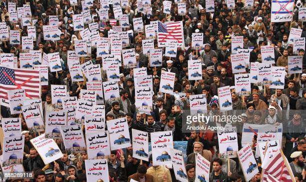Afghan Muslims hold placards as they stage a protest against US President Donald Trump's announcement to recognize Jerusalem as the capital of Israel...
