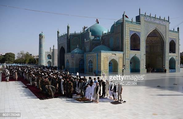 Afghan Muslims offer EidalAdha prayers at the Hazrati Ali shrine in Mazari Sharif on September 12 2016 Afghans started celebrating Eid alAdha or...