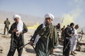 Afghan National Army cadets dressed as Taliban walk back to base following a Taliban capture military exercise overseen by French and Canadian...