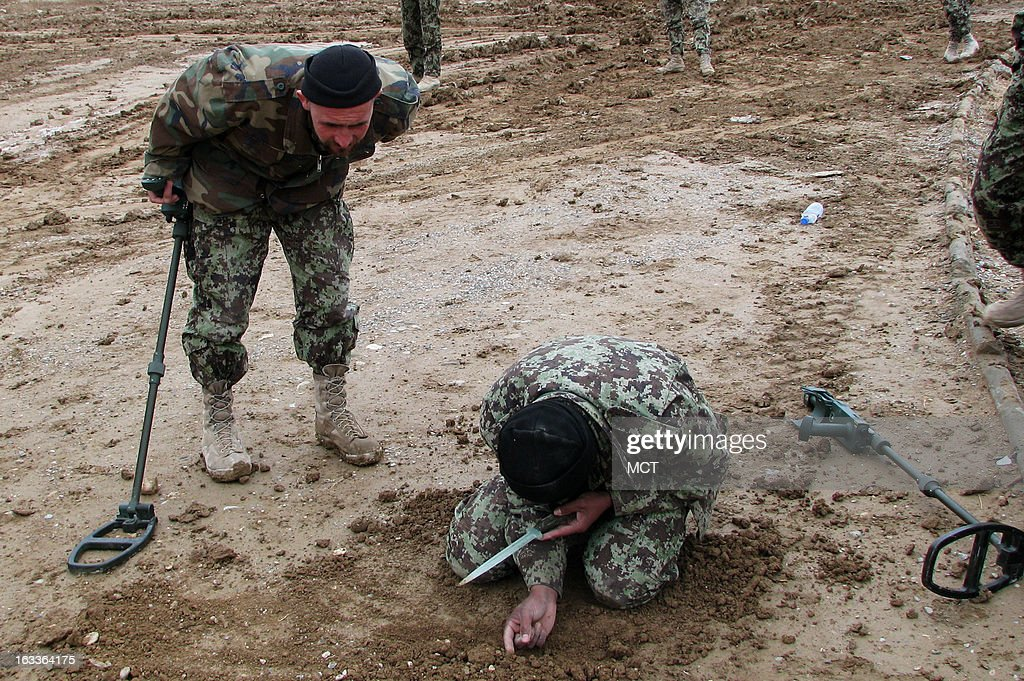 Afghan National Army engineers train on how to dig out triggers on improvised explosive devices at a training center in Qalat, Afghanistan.