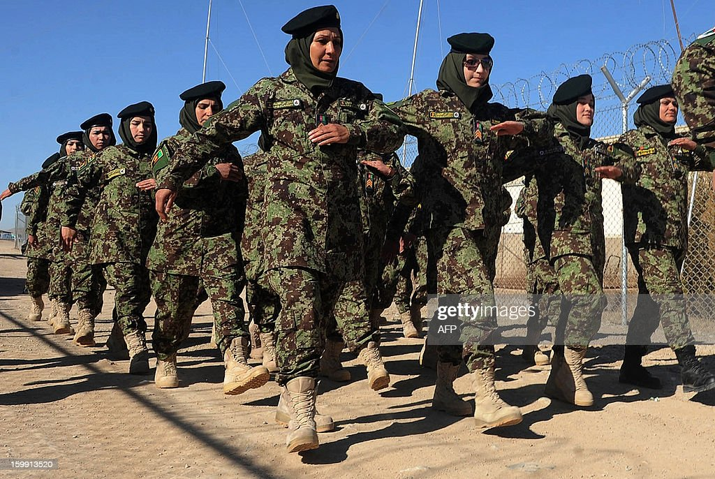 Afghan National Army (ANA) female officers march during their graduation ceremony at the ANA training centre in Herat on January 22, 2013. International troops in Afghanistan and all NATO-led combat forces are due to leave by the end of 2014, when Kabul will assume responsibility for the country's security. Some 300,000 Afghan Army and Police personnel have been trained so far. AFP PHOTO/ Aref Karimi