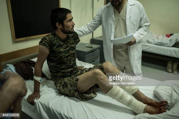 Afghan National Army soldier Ahmad Jawad lies in the ANA 215th Corp hospital after being shot in the legs during a firefight with the Taliban on...