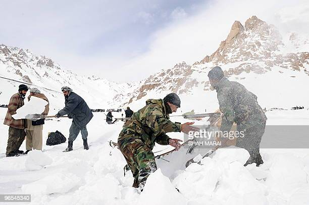 Afghan National Army soldiers and policemen search for bodies in the snow after avalanches killed at at least 165 people in the Salang tunnel in...