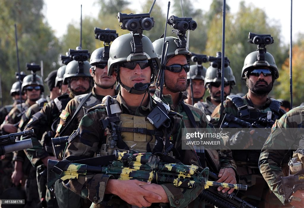 Afghan National Army soldiers attend a handover ceremony of NATO's International Security Assistance Force in Kandahar province on January 11 2015...