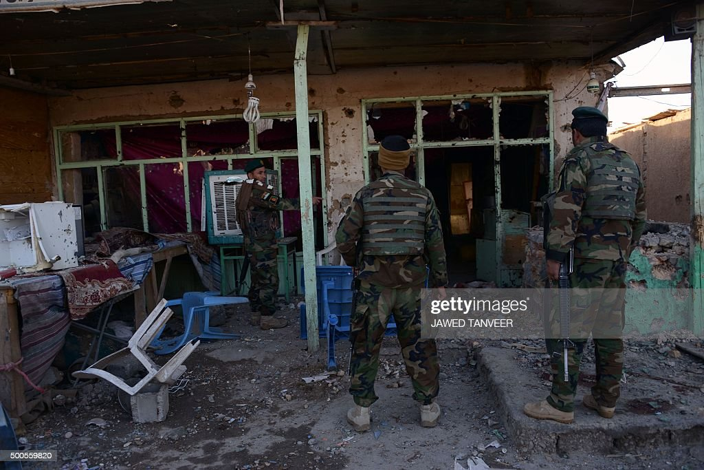 Afghan National Army soldiers inspect buildings after clashes against security forces at Kandahar Airport on December 9 a sprawling complex which...