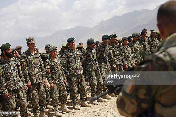 Afghan National Army soldiers line up after training exercises and tactical manoeuvres operated by French Army's mentors members of the 'Epidote'...