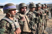 Afghan National Army soldiers participate in a flaglowering ceremony at Camp Maiwand on April 2 2014 near Pule Alam Afghanistan Tomorrow most of the...