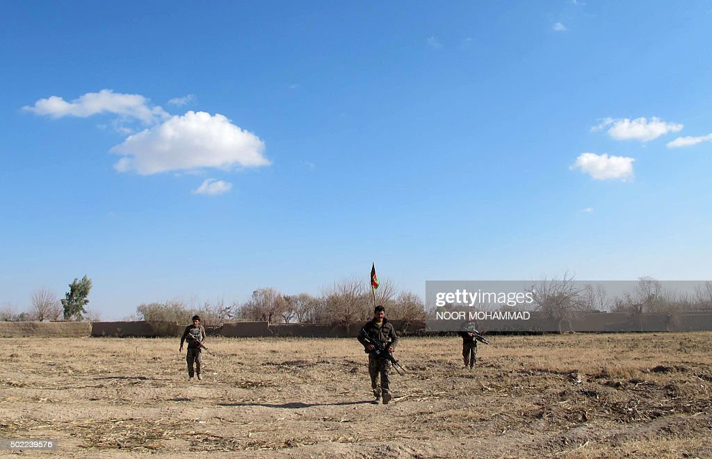 Afghan National Army soldiers patrol during an ongoing battle with Taliban militants in the Nad Ali district of Helmand on December 22 2015 Military...
