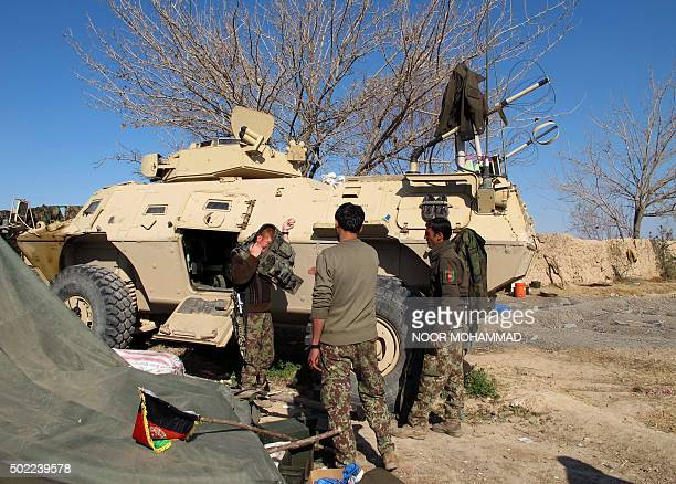 Afghan National Army soldiers prepare for combat during an ongoing battle with Taliban militants in the Nad Ali district of Helmand on December 22...