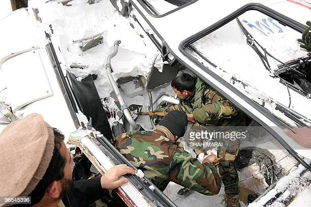Afghan National Army soldiers search for bodies in the snow after avalanches killed at at least 165 people in the Salang tunnel in Parwan province on...