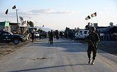 Afghan National Army soldiers stand alert after clashes against security forces at Kandahar Airport on December 9 a sprawling complex which also...