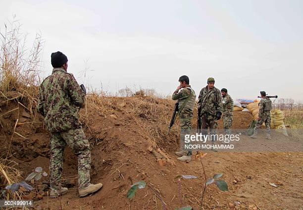 Afghan National Army soldiers stand guard during an operation against Taliban militants in the Nad Ali district of Helmand on December 26 2015 Afghan...