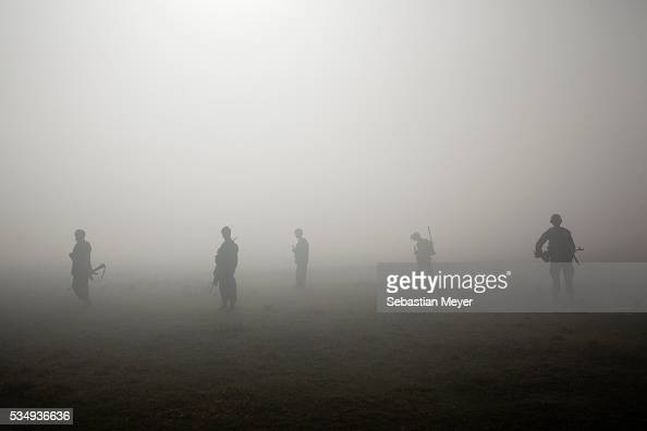 Afghan National Army soldiers stand silhouetted against a smoke screen during a partnered operation Bravo 'Bonecrusher' Troop of the 175 Cavalry...