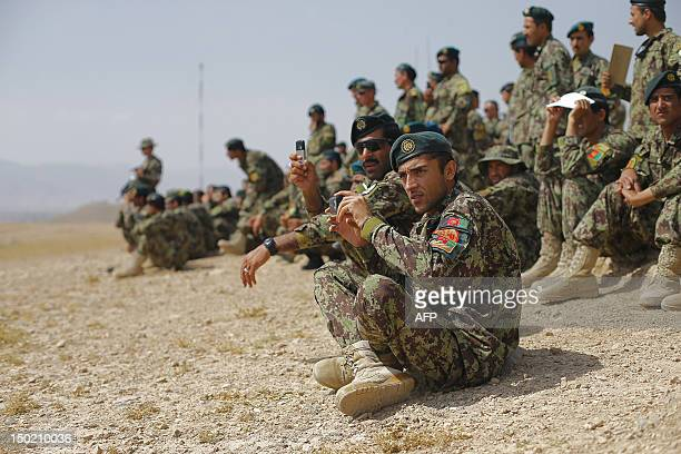 Afghan National Army soldiers watch training exercises and tactical manoeuvres operated by French Army's mentors members of the 'Epidote' unit at...