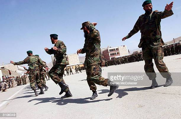 Afghan National Army soldiers with the 15th Kandak perform a cultural dance during graduation ceremonies at the Kabul Military Training Center on...