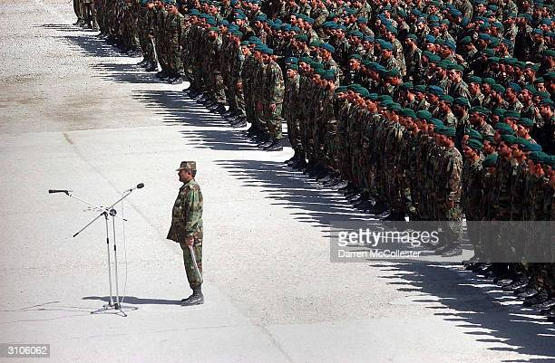 Afghan National Army soldiers with the 15th Kandak stand in formation during graduation ceremonies at the Kabul Military Training Center on March 18...