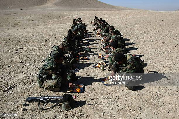 Afghan National Army trainee officers share a meal after training with the French army within the framework of Epidote progamme at the Kabul Military...