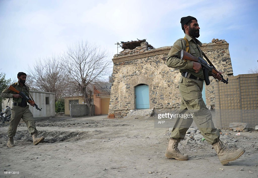 Afghan National Police (ANP) and Local Police (ALP) personnel walk during a patrol in Koz Kunar district Nangarhar province on February 13, 2013. The Afghan government welcomed President Barack Obama's announcement that the United States will withdraw 34,000 troops from the war-torn country over the next year. NATO, which has about 37,000 troops in Afghanistan, will also withdraw them in stages before the end of 2014. AFP PHOTO/ Noorullah Shirzada