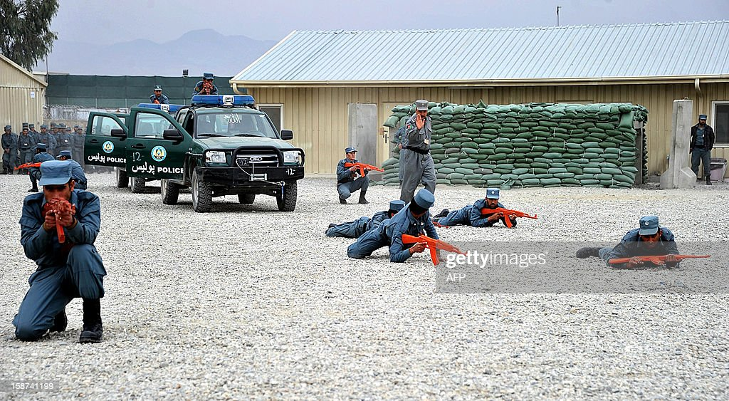 Afghan National Police (ANP) hold 'rubber ducks' - fake training weapons - during a demonstration drill at a graduation ceremony at a police training centre in the outskirts of Jalalabad on December 27, 2012. Over 177 police officers graduated after a sixteen-week course. AFP PHOTO/ Noorullah Shirzada