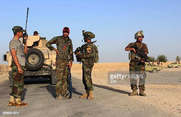 Afghan National Security Forces patrol during a military operation in Helmand province on August 12 following clashes with Taliban insurgents...