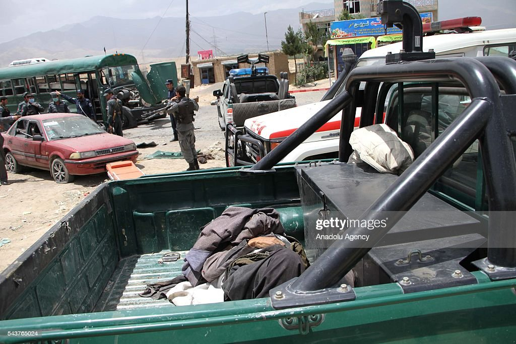 Afghan officials carry the victims of explosion in Kabul, Afghanistan on June 30, 2016. The buses carrying police cadets were targeted as they were on their way from the neighboring Maidan Wardak province to Kabul. According to the preliminary reports, at least 30 policemen have lost their lives and dozens of others injuries.