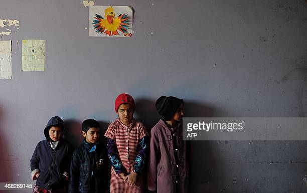 Afghan orphans are pictured during a class in an orphanage in MazariSharif on February 9 2014 Afghanistan remains one of the most dangerous places in...