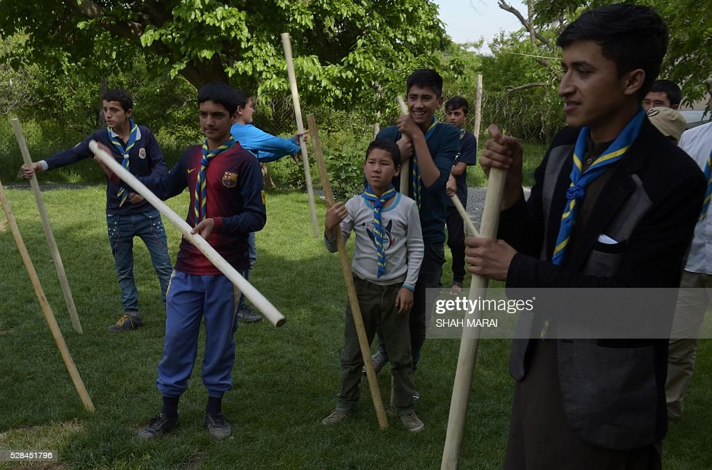 Afghan orphans play a game at the Physiotherapy and Rehabilitative Support for Afghanistan (PARSA) NGO which supports vulnerable women and children in Kabul on May 5, 2016. Prince was famous worldwide for his music and extravagant outfits, but he was also a secret philanthropist in war-torn Afghanistan, quietly donating thousands to Scout masters caring for young orphans, a charity told AFP May 5. The pop icon, who died suddenly last month at the age of 57, gave tens of thousands of dollars to Physiotherapy and Rehabilitative Support for Afghanistan (PARSA), an NGO supporting vulnerable women and children, according to its executive director. MARAI