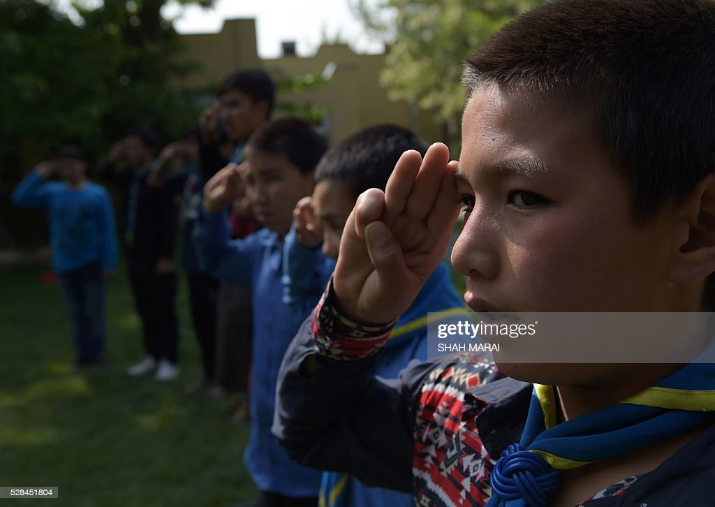 Afghan orphans salute before taking part in a quiz at the Physiotherapy and Rehabilitative Support for Afghanistan (PARSA) NGO which supports vulnerable women and children in Kabul on May 5, 2016. Prince was famous worldwide for his music and extravagant outfits, but he was also a secret philanthropist in war-torn Afghanistan, quietly donating thousands to Scout masters caring for young orphans, a charity told AFP May 5. The pop icon, who died suddenly last month at the age of 57, gave tens of thousands of dollars to Physiotherapy and Rehabilitative Support for Afghanistan (PARSA), an NGO supporting vulnerable women and children, according to its executive director. MARAI