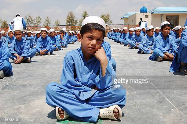 Afghan orphans sit in lines at an orphanage in Kandahar on November 19 2012 Two decades of war in Afghanistan has left some one million orphans and...