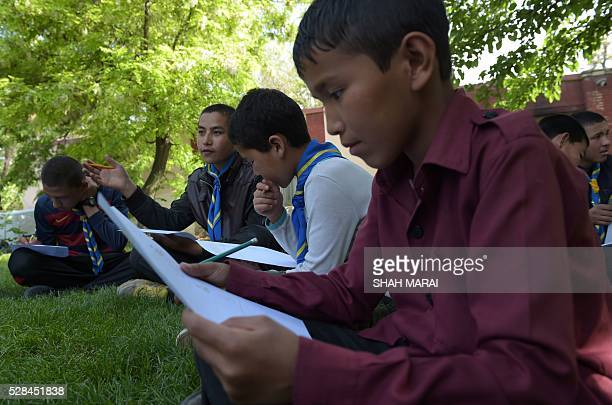 Afghan orphans take part in a quiz at the Physiotherapy and Rehabilitative Support for Afghanistan NGO which supports vulnerable women and children...