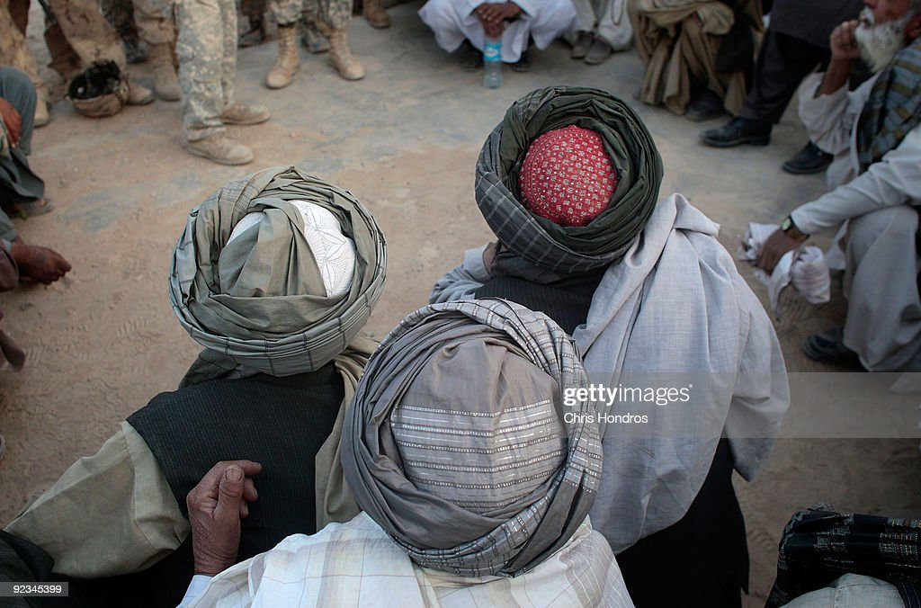Afghan Pashtun tribal elders sit in a traditional meeting to discuss American and Canadian military actions on their lands October 26, 2009 in the village of Hazi Madad in the Kandahar province of Afghanistan. American and Canadian troops in the area have been trading blows with Taliban militant fighters in recent battles, but local tribal chiefs complain that civilians have been caught in the crossfire.